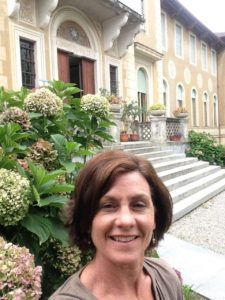 Etta Madden in front of Waldensian library archive Italy
