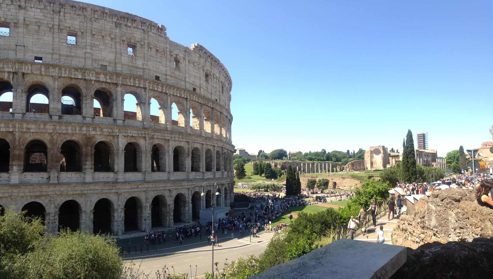 photo of site teacher Etta Madden lead group to colosseum Rome Italy