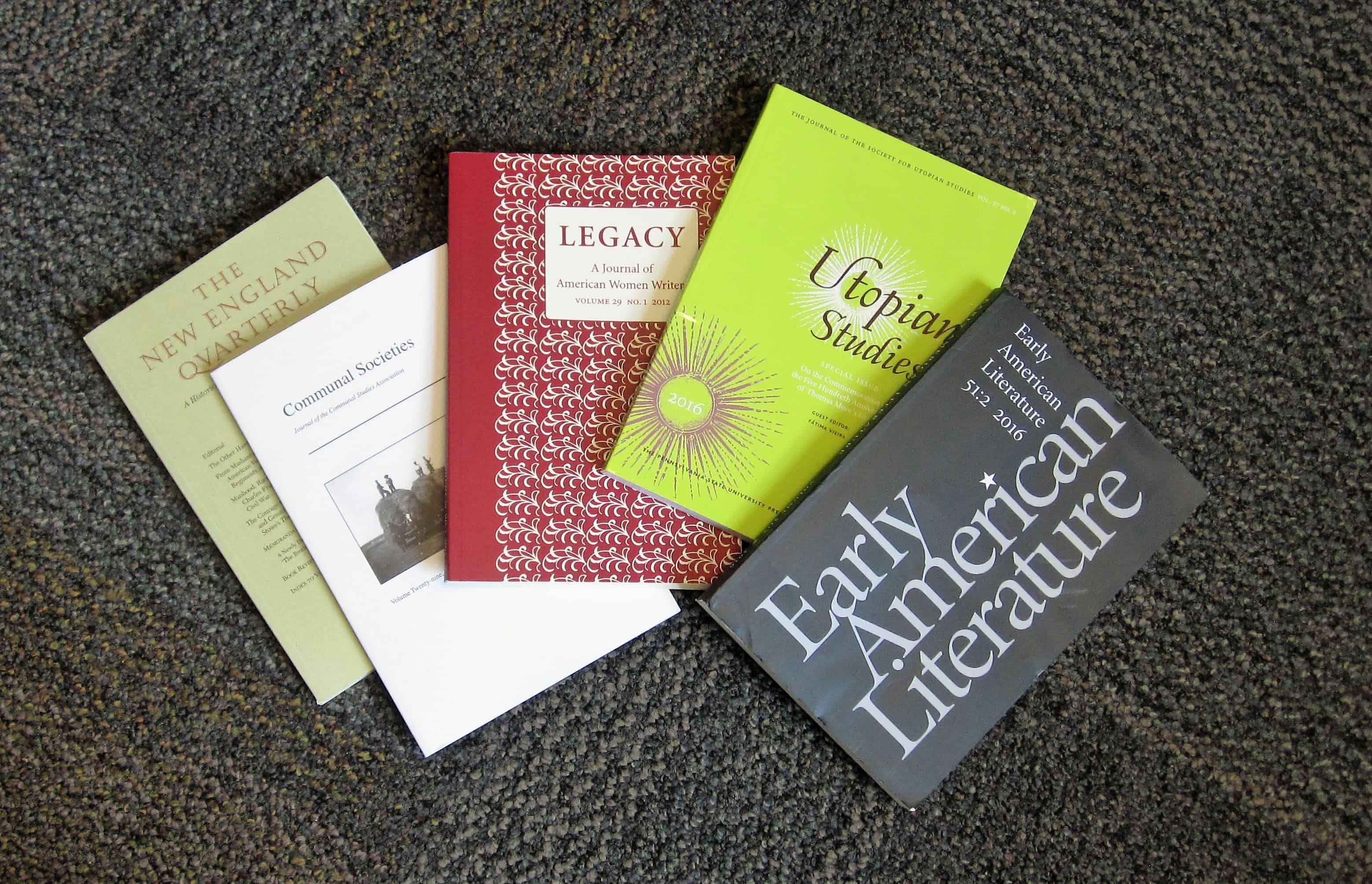 Photo of journals with book reviews by Etta Madden